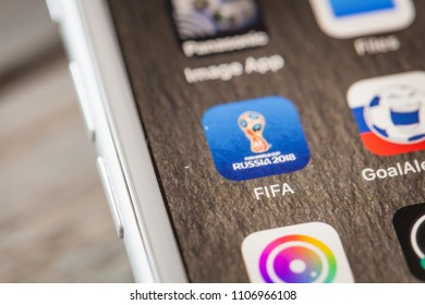 BERLIN, GERMANY - JUNE 6, 2018: Close up to FIFA World Cup app for Russia 2018 on the screen of an iPhone 7 Plus with personalized background.