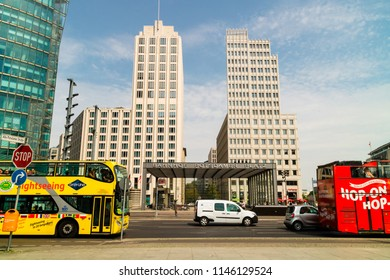BERLIN, GERMANY - June 6, 2018: Sightseeing buses at Potsdamer Platz (Potsdam Square), unique urban space central to Berlin and its history.