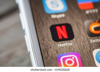 BERLIN, GERMANY - JUNE 6, 2018: Close up to video and series streaming app Netflix on the screen of an iPhone 7 Plus with personalized background.