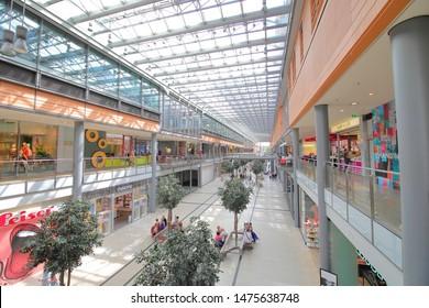 BERLIN GERMANY - JUNE 8, 2019: Unidentified people visit Arkaden shopping mall Berlin Germany