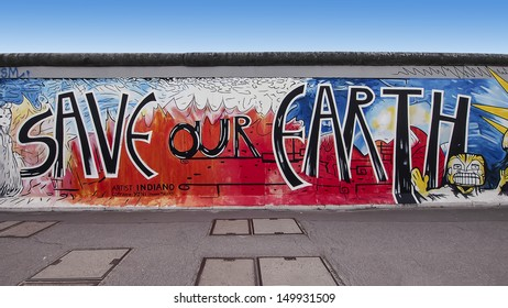 BERLIN, GERMANY - JUNE 8:  Graffiti on Berlin Wall at East Side Gallery on June 8, 2013 in Berlin. Famous 1.3km long memorial of the original wall.