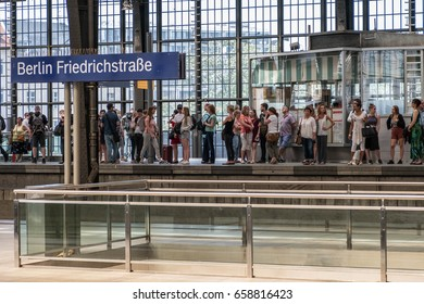 Berlin, Germany - june 9, 2017: People standing  on platform and waiting for S-Bahn train station Berlin Friedrichstrasse