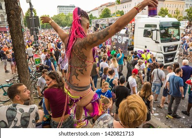 Berlin, Germany - June 9, 2019: Carnival of Cultures Parade Karneval der Kulturen Umzug - a multicultural music festival in Kreuzberg. Dancing punk woman in revealing bikini clothes with dreadlocks