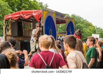 Berlin, Germany - June 9, 2019: Carnival of Cultures Parade Karneval der Kulturen Umzug - a multicultural music festival in Kreuzberg. Bright charismatic singer performing on truck stage