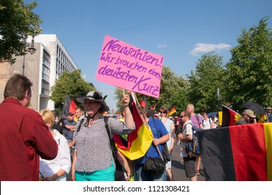 Berlin, Germany - June 9,2018: These signs were being displayed at the far right wing woman's activist march protesting immigration and refugees as seen on this date near Parisser Plaza
