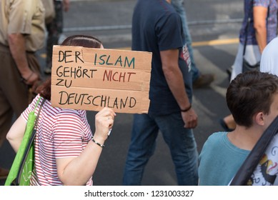 Berlin, Germany - June 9th 2018: The big women's rights demo. A woman is holding a sign stating that islam does not belong to Germany