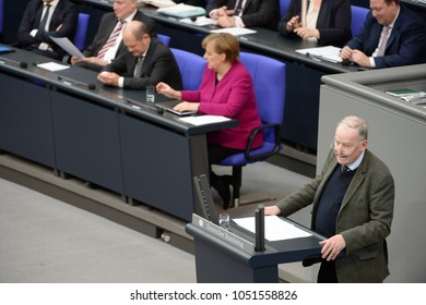 BERLIN, GERMANY,  - Mar 21, 2018: Alexander Gauland, AfD, at his speech at the Bundestag, in the background German chancellor Dr. Angela Merkel (r) and Olaf Scholz, German Minister of Finance