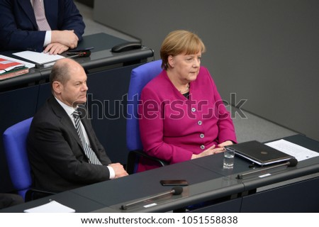BERLIN, GERMANY,  - Mar 21, 2018: German chancellor Dr. Angela Merkel and Olaf Scholz, German Minister of Finance at the Bundestag