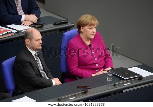 BERLIN, GERMANY,  - Mar 21, 2018: German chancellor Dr. Angela Merkel and Olaf Scholz, German Minister of Finance at the Bundestag
