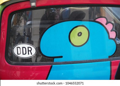 Berlin, Germany : March 01, 2017: detail of a Trabant , the typical DDR ( East Gemany) car with drawing on it. you can see the DDR car sticker