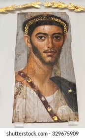 BERLIN, GERMANY - MARCH 05, 2013: Fayum portrait in Altes Museum. Fayum mummy portraits is a type of naturalistic painted portraits on wooden boards attached to mummies  of Egypt during Roman times