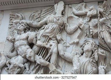 BERLIN, GERMANY - MARCH 06, 2013: Detail of the frieze of the Pergamon Altar in the Pergamon Museum. Altar was built in the 2nd century in the ancient Greek city of Pergamon in Asia Minor