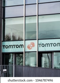Berlin, Germany - March 11, 2018: Logo of the Dutch company TomTom that produces traffic, navigation and mapping products, action cameras, GPS sport watches, and fleet management systems