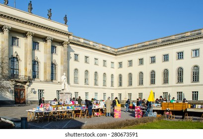 BERLIN, GERMANY, MARCH 12, 2015: people are buying used books on a flee market held in front of the humboldt university in berlin.