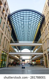 BERLIN, GERMANY, MARCH 12, 2015: giant shopping mall with high glass ceiling and huge arcade situated on the opposite side of the street from bundesrat building in berlin.
