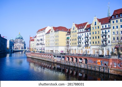 BERLIN, GERMANY, MARCH 12, 2015: view of the riverside of spree river in berlin with famous berlin cathedral at the far end.