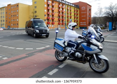 Berlin, Germany - March 12, 2019: Motorcycle escorting car from Belgium embassy