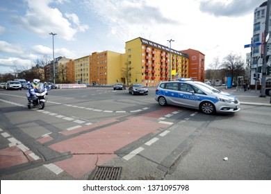 Berlin, Germany - March 12, 2019: Police officer on motorcycle and police car escorting cars from Belgium embassy