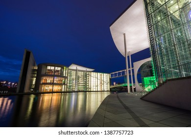 Berlin, Germany - March 12, 2019: Illuminated modern governmental buildings Paul-Loebe-House and Marie-Elisabeth-Luders-Haus by the Spree River in Berlin, Germany, at dusk.