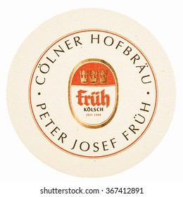 BERLIN, GERMANY - MARCH 15, 2015: Beermat of German beer Frueh isolated over white background vintage