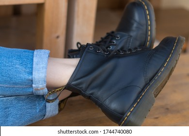 Berlin, Germany - March 16, 2020: Classic black leather Dr. Martens boots. Dr Martens is an English footwear, accessories and clothing brand