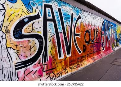 BERLIN, GERMANY - MARCH 20: Berlin Wall graffiti seen on March 22, 2015, Berlin, East Side Gallery. It's a 1.3 km long part of original Berlin Wall which collapsed in 1989.