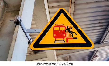 Berlin, Germany - March 23, 2019: Berlin Schonefeld Airport Trainstation S Bahn warning sign to not stand near the edge of the platform