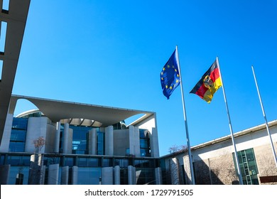 Berlin, Germany - March 24, 2020: The Federal Chancellery (German: Bundeskanzleramt), official residence and executive office of the Chancellor of Germany, with waving flags of Germany and the EU.