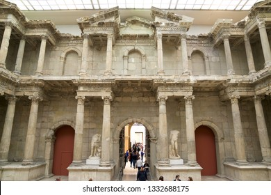 BERLIN, GERMANY - MARCH 25, 2016: Tourists visiting Market Gate of Miletus in Pergamon Museum.