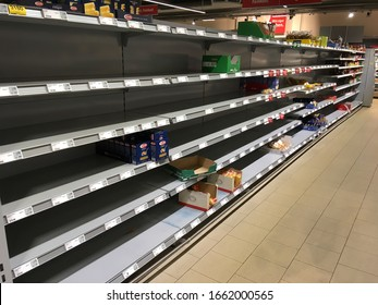 """Berlin, Germany - March 3 2020: Emtpy shelves in a """"REWE"""" supermarket in Berlin Prenzlauer Berg due to panic shopping because of Corona-Virus"""