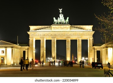 BERLIN, GERMANY - MARCH 30, 2014: Tourists visit the Reichstag building in Berlin, Germany at night