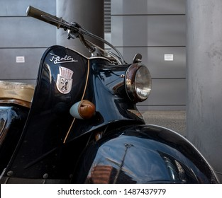 Berlin; Germany, March, 30, 2019, Berlin Coat of arms on an old retro style Vespa