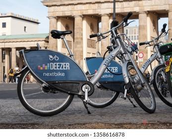 BERLIN, GERMANY - MARCH 31, 2019: Public Bike Sharing Service Provider: Deezer Nextbike Bicycle In Front of Brandenburg Gate In Berlin, Germany