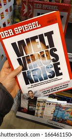 "Berlin / Germany - March 5, 2020: Cover of popular ""Der Spiegel"" magazine from a spuermarket shelf, with the German text saying ""Welt Virus Krise"", or World Virus Crisis."