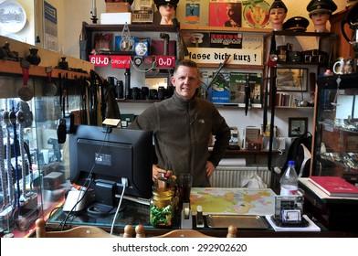 BERLIN, GERMANY - MARCH 5: Unidentified salesman in antique shop on the Warschauer Strasse on March 5, 2015.