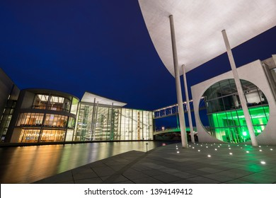 Berlin, Germany - March 9, 2019: Illuminated modern governmental buildings Paul-Loebe-House and Marie-Elisabeth-Luders-Haus by the Spree River in Berlin, Germany, at dusk.