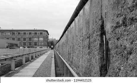 Berlin, Germany - March 9th 2017: Remnants of Berlin Wall at Niederkirchnerstrasse near Checkpoint Charlie, high contract black and white image.