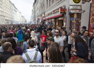 BERLIN, GERMANY - MAY 01, 2013: Crowd of people celebrating traditional labor day at the first of May in Kreuzberg