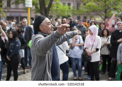 BERLIN, GERMANY - MAY 01, 2013: Turkish man dancing in front of people celebrating may day at the first of May in Kreuzberg