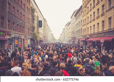 BERLIN, GERMANY - MAY 01, 2017: Crowd of people celebrating traditional labor day at the first of May in the streets of Kreuzberg