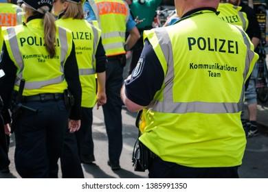 Berlin, Germany - May 01, 2019: Police team on street at myfest celebration on mayday , 1. mai, Berlin, Kreuzberg