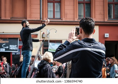 Berlin, Germany - May 01, 2019: People  taking picture with mobile phone on street parade on labor day in Berlin