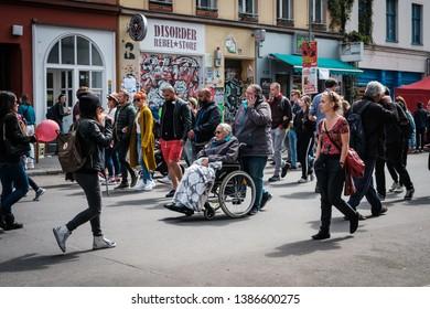 Berlin, Germany - May 01, 2019: Many people on crowded street on labor day in Berlin, Kreuzberg