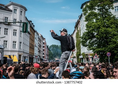 Berlin, Germany - May 01, 2019: Person on ladder taking picture of crowded street festival on labor day in Berlin, Kreuzebreg