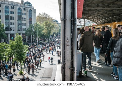 Berlin, Germany - May 01, 2019: Many people on crowded street and train station on labor day in Berlin, Kreuzeberg