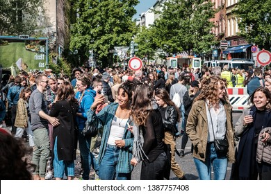 Berlin, Germany - May 01, 2019: Happy young people on crowded street celebrating labor day in Berlin, Kreuzebrg