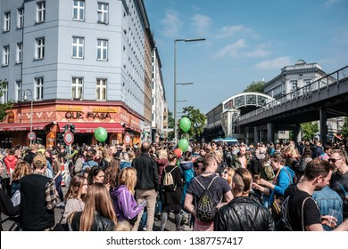 Berlin, Germany - May 01, 2019: Happy young people on crowded street celebrating labor day in Berlin, Kreuzeberg