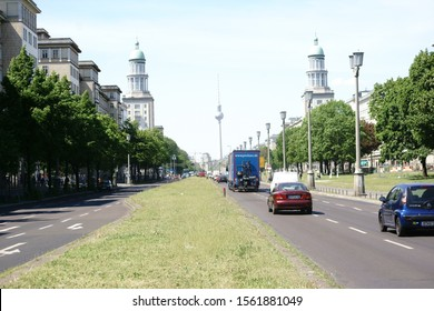 BERLIN, GERMANY - MAY 09: Road traffic along the Karl-Marx-Allee with the towers of the Frankfurter Tor in the district Friedrichshain on May 09, 2016 in Berlin.