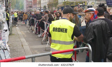 Berlin, Germany, May 1, 2017: Security staff in front of a public stage at the labor day festivities