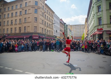 BERLIN, GERMANY - MAY 1, 2017: street artist in front of a crowded street in Kreuzberg during may day / labor day on the first of may.